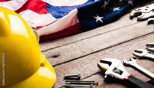 Fotografie, Tablou USA Labor day concept, Top view flat lay of different kinds wrenches with American flag on wood table