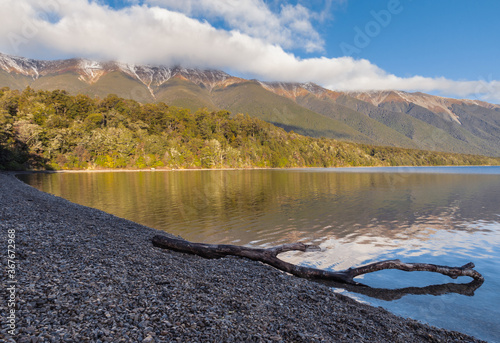 Saint Arnaud Range reflecting in lake Rotoiti in Nelson Lakes National Park, Sou Wallpaper Mural