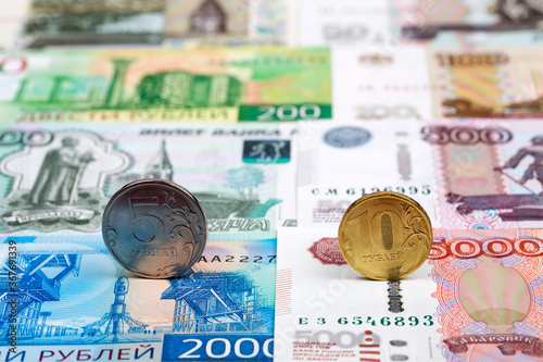 Fototapeta Russian coins - ruble on the background of money