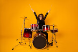 Full body photo of popular rocker redhair lady plays instruments raise hands drum sticks concert show performance repetition wear black leather outfit sun glasses isolated yellow background
