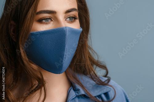 Canvastavla Woman wearing stylish protective blue face mask