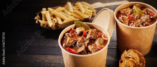 Fotografie, Obraz Double serving of takeaway beef goulash in tubs