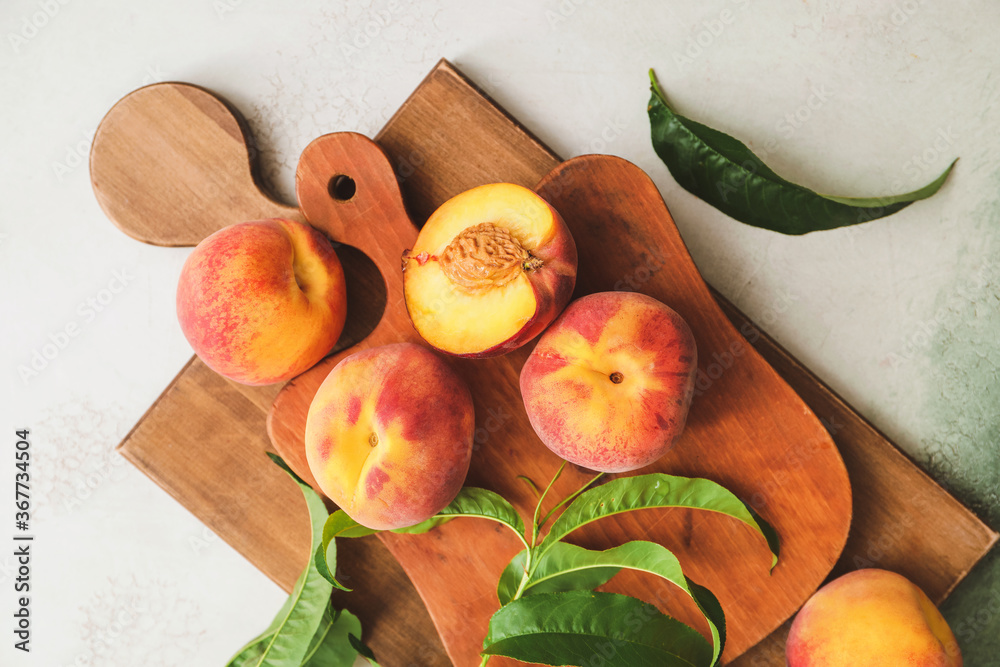 Fototapeta Boards with ripe peaches on light background