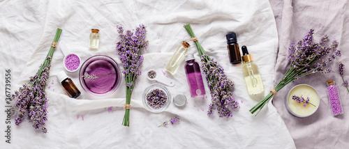 Canvas Print Lavender oils serum lavender flowers on white