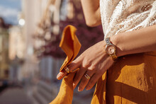 Close Up Of Fashion Accessories, Street Style Details: Elegant Golden Wrist, Hand Watch, Rings. Woman Posing In European City. Copy, Empty Space For Text