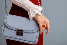 Close Up Of Fashionable Elegant Woman`s Outfit: Trendy Small Blue Faux Leather Bag, Stylish Wrist Watch, Beautiful Ring With Red Gem. Copy, Empty Space For Text