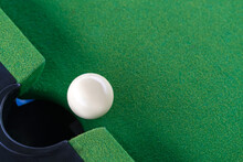 Snooker White Ball Near The Hole On Green Snooker Table