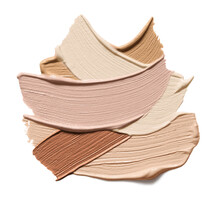 Makeup Foundation Swatches Isolated On White Background. Brown Color Correcting Cream Strokes Of Various Shades. Skin Tone Concealer Smear Smudge