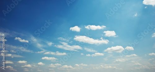 Obraz The beautiful blue sky with lots of clouds in the daytime - fototapety do salonu