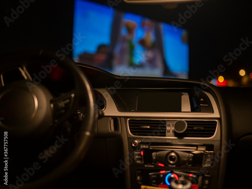 Cuadros en Lienzo car interior in a drive-in watching a movie
