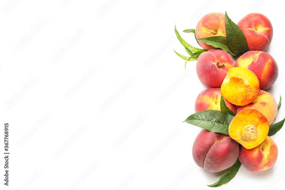Fototapeta Many ripe peaches on light background