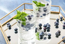 Glasses With Ice And Frozen Berries On Tray
