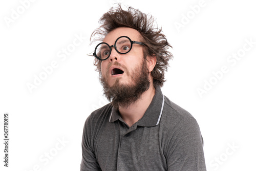 Fotomural Crazy Scared or Shocked Bearded Man with funny Haircut in Eyeglasses looks Worried