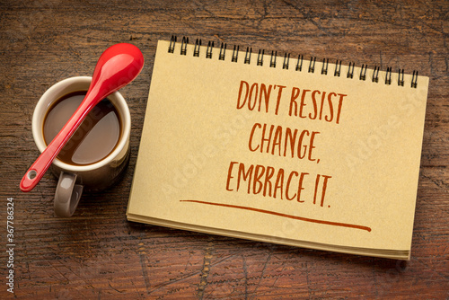 Obraz do not resist change, embrace it - motivational phrase in a spiral sketchbook with a cup of coffee, business, education and personal development concept - fototapety do salonu