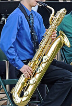 Young Man Playing Bari Saxopho...