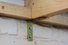 Strengthening Roof Wooden Beam...