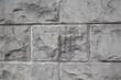 Garten und Landschaftsbau: Hintergrund Mauer Wand aus grauen Natursteinen mit unregelmäßiger Oberfläche