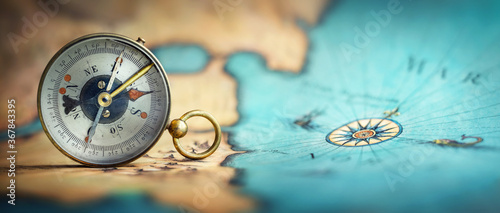 Magnetic old compass on world map Wallpaper Mural