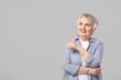 canvas print picture - Stylish senior woman on grey background