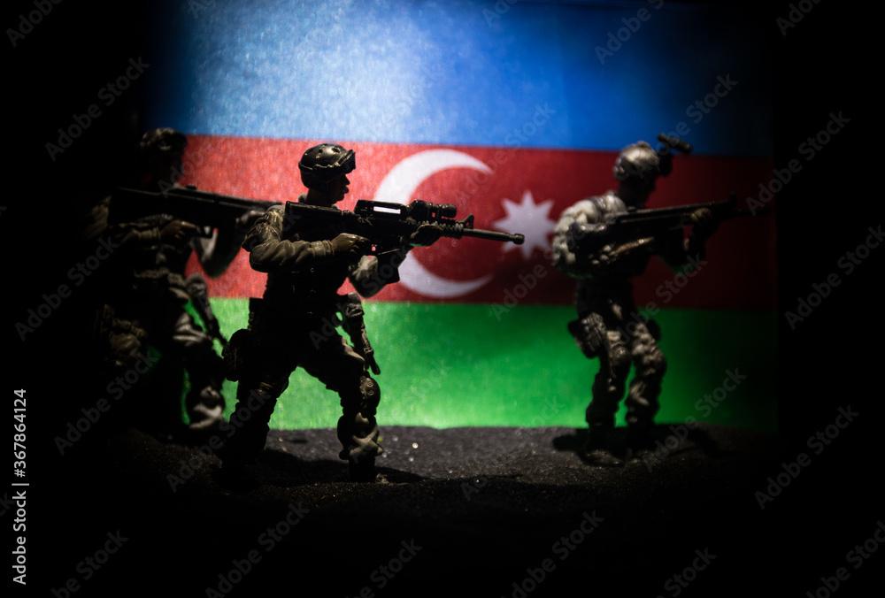 Fototapeta Azeri army concept. Silhouette of armed soldiers against Azerbaijani flag. Creative artwork decoration. Military silhouettes fighting scene dark toned foggy background.