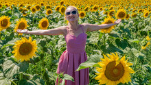 Girl In Sunflowers In A Red Dr...