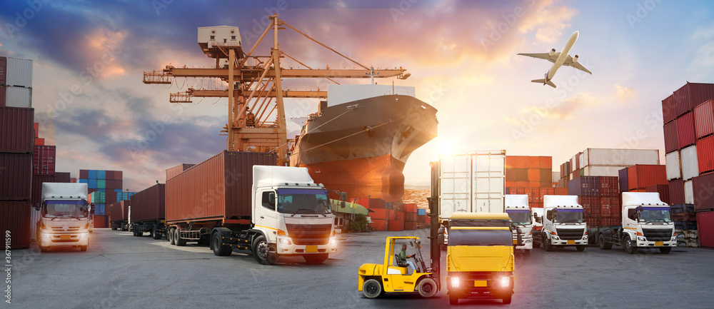 Fototapeta forklift handling container box loading to truck in import export logistic, Business logistics concept