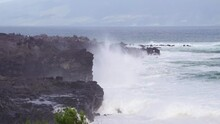 Large Wave Crashes On Hawaiian Shores. West Side Of Maui Hawaii. Molokai In The Distance. Tourists On Rocks. High Dangerous Surf.