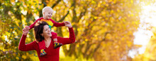 Mother And Baby In Autumn. Fal...