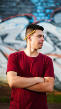 Young Man With Pencil Behind Ear On Graffiti Background