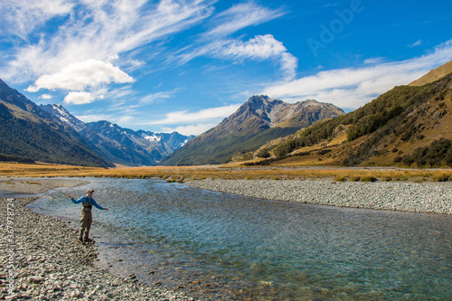 Valokuvatapetti A fly fisherman casting for trout on the Ahuriri River in New Zealand