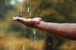 rain water falling on hand