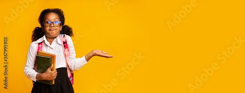 Puzzled African American Schoolgirl Shrugging Shoulders Over Yellow Background, Fototapet