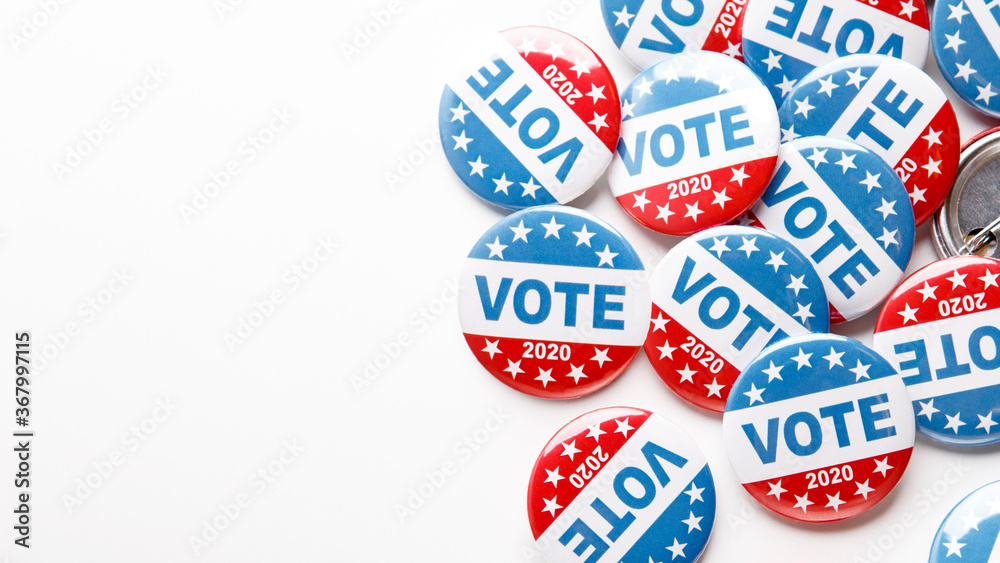 Fototapeta Pile of patriotic voting buttons on white background
