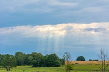 Dark Clouds With The Sun Peeki...