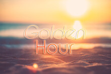 Golden Hour Words On Blur Tropical Sand Beach With Bokeh Sunlight Wave Abstract Background. Copy Space Of Business Summer Vacation And Travel Adventure Concept.