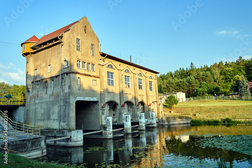 Obraz the river and the building of a historic hydroelectric power plant in Bledzew in Poland - fototapety do salonu