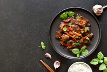 Thai Beef Stir-fry With Pepper And Basil On Plate
