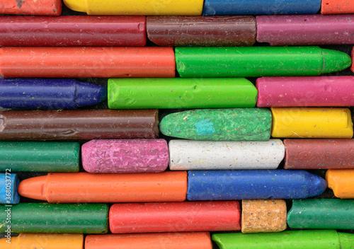 Obraz na plátně Multi-colored children's crayons for the backdrop