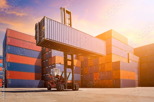 Logistic cargo container in shipping yard with cargo container stack in background Wallpaper Mural