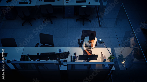 Working Late at Night in the Office: Businesswoman Using Desktop Computer, Analyzing, Using Documents, Solving Problems, Finishing Project Fotobehang