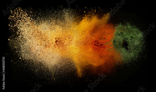 Obraz Freeze motion of spice explosion, black background - fototapety do salonu