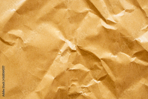 Brown crumpled paper recycled kraft sheet texture background