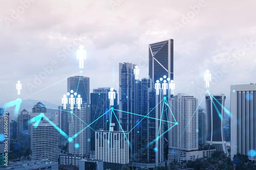 Fotografie, Tablou Social media icons hologram over panorama city view of Kuala Lumpur, Malaysia, Asia