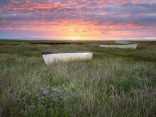 Firey Sky Over Salt Marsh Boats