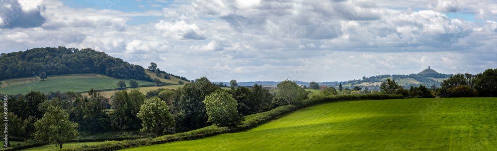 Fototapeta Panoramic landscape view of Somerset countryside with historic Glastonbury Tor