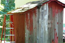 Old Red Shed With A Ladder.