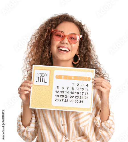 Young woman with calendar on white background. Vacation concept