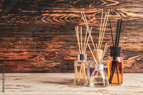 Fototapeta Different reed diffusers on table obraz