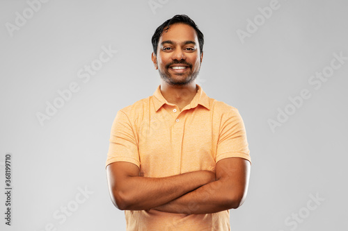 Fototapeta people and furniture concept - portrait of happy smiling young indian man with c