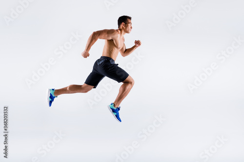 Obraz Full length body size view of his he nice attractive powerful professional sportive focused purposeful guy jumping running motivation isolated over light white pastel color background - fototapety do salonu